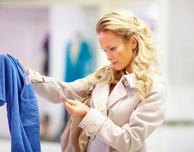 Young woman checking a sales tag